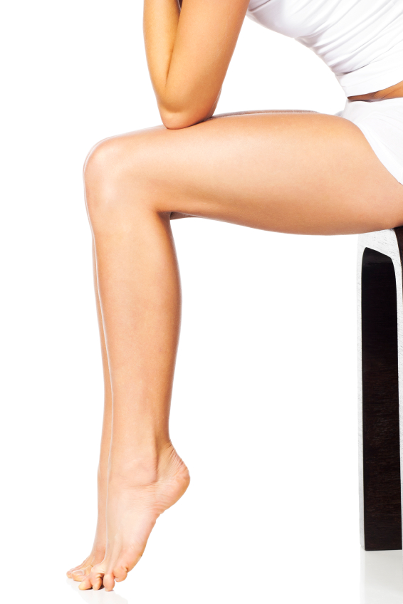 Thin and long feet of the beautiful sitting woman
